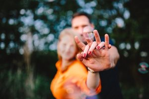kaboompics-com_young-couple-holding-hands-outdoors